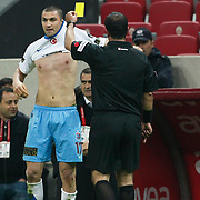 Referee's Bunyamin GEZER show the yellow card to Trabzonspor's Burak YILMAZ (L) during their Turkish superleague soccer derby match Galatasaray between Trabzonspor at the TT Arena in Istanbul Turkey on Sunday, 10 April 2011. Photo by TURKPIX