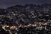 Looking down on city of Taunggyi with buildings and street lights at night
