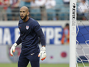 JACKSONVILLE, FL - JUNE 07:  Goalie Tim Howard #1 of the United States warms up before the international friendly match against Nigeria at EverBank Field on June 7, 2014 in Jacksonville, Florida.  (Photo by Mike Zarrilli/Getty Images)