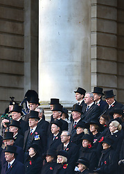 © Licensed to London News Pictures. 11/11/2012. City of London, UK Members of the Military and bankers and staff from the Bank of England and the London Stock Exchange. The war memorial outside the Stock exchange and the Bank of England, People gather at a service of remembrance to remember those killed in action during conflict fighting for the UK. The Stock Exchange, today 11 November 2012. Both Armistice Day and Remembrance Sunday fall of the same day this year. Photo credit : Stephen Simpson/LNP