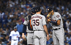 October 31, 2017 - Los Angeles, California, U.S. - Houston Astros' catcher Brian McCann (15), left, and second baseman Carlos Correa (1), right, talk to starting pitcher Justin Verlander (35) with Los Angeles Dodgers' Joc Pederson (not pictured) up to bat in the 2nd inning of game six of a World Series baseball game at Dodger Stadium on Tuesday, Oct. 31, 2017 in Los Angeles. (Photo by Keith Birmingham, Pasadena Star-News/SCNG).Houston Astros' Carlos Correa (Credit Image: © San Gabriel Valley Tribune via ZUMA Wire)