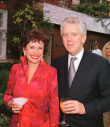 SIR CHARLES & LADY POWELL at a dinner in London on 24th May 1999.MSK 19