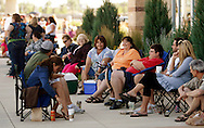 """People wait in line with friends and family for an open casting call for season 11 of """"The Biggest Loser"""" television show in Broomfield, Colorado July 17, 2010. Over 600 people vied for a chance to be on the show and win $250,000.   REUTERS/Rick Wilking (UNITED STATES)"""
