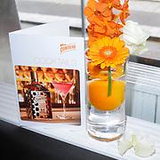 NLD/Amsterdam/20120514 - Presentatie Cointreau fles vol strikjes ontworpen door Alexis Mabille, Oranje versiering op de Cointreau party