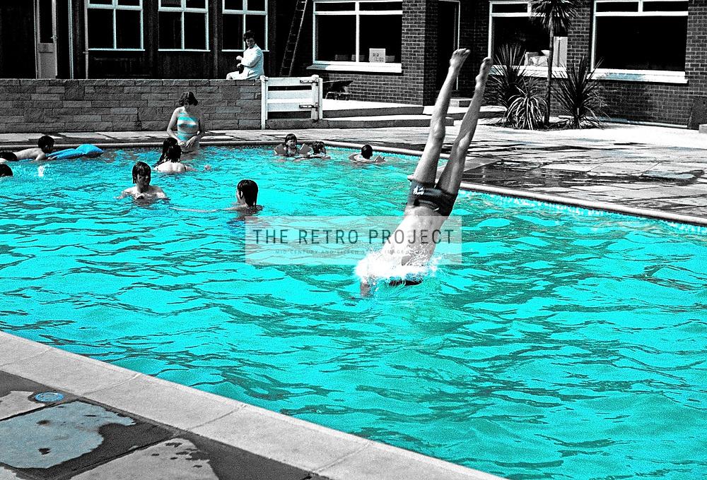 Vintage monochrome swimming pool grainy image blue colourised