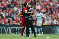 Football - 2018 / 2019 Premier League - Liverpool vs. West Ham United<br /> <br /> A pitch invader runs on to meet Mohamed Salah of Liverpool at Anfield.<br /> <br /> COLORSPORT