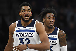 November 14, 2018 - Minneapolis, MN, USA - The Minnesota Timberwolves' Karl-Anthony Towns (32) and Robert Covington (33) walk back to the bench after a New Orleans Pelicans time out in the first quarter on Wednesday, Nov. 14, 2018, at Target Center in Minneapolis. (Credit Image: © Aaron Lavinsky/Minneapolis Star Tribune/TNS via ZUMA Wire)