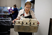 Bernis Chavez carries meals to be delivered to Torrance County senior citizens. New Mexico has received more than $601,000 for senior meals programs around the state.