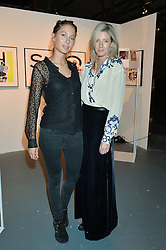 Left to right, business partners JEMIMA JONES and LUCY CARR-ELLISON at the Women for Women International Catwalk Show & Auction in partnership with Brown's and sponsored by Swarovski held at The Vinyl Factory, Brewer Street Space, Brewer Street, London on 20th November 2014.