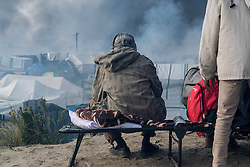 October 26, 2016 - Calais, France - Chaotic scenes of the jungle, after many fires being set up in Calais, France on  26 October 2016. During the whole day, fires were set up all around the camp. Many tents, shops were burnt. Firemen, with the support of the French police, managed to keep the situation under control. However, around 1 o colck the jungle was evacuated in order to keep everyone safe. (Credit Image: © Guillaume Pinon/NurPhoto via ZUMA Press)