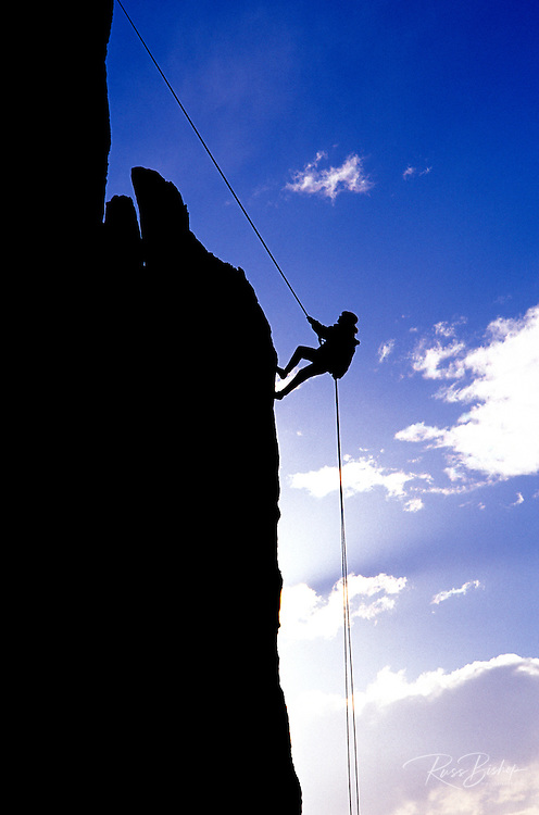 Climber rappelling from the summit of Eichorn Pinnacle, Tuolumne Meadows, Yosemite National Park, California USA