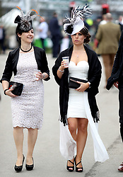 Female racegoers arrive for the Grand National Day of the 2018 Randox Health Grand National Festival at Aintree Racecourse, Liverpool.