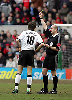 Photo: Paul Thomas. Nottingham Forest v Derby County. Forest Ground, Nottingham. Coca Cola Championship. 26/02/2005. Grzegorz Rasiak recieves a yellow card from referee Mr S Pike.