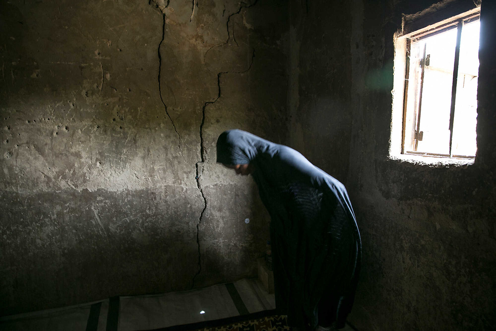 Aisha BG, 28, prays in her rented mud house in the outskirts of Maiduguri, Nigeria, April 29, 2019. When Boko Haram attacked her village in Bama Local Government in 2014, they killed her husband and kidnapped two children. She walked to the Sambisa Forest to save her children, but ended up getting married to a commander for survival. Two and half years later, she was joined by her children as the commander died and she refused to marry another fighter by claiming she had contracted HIV. She is pregnant again with a member of civilian joint task force; however, she refused to marry him and he has disappeared. She expects to give birth in June.