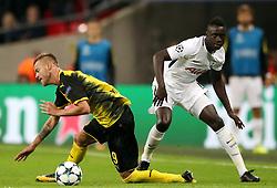Borussia Dortmund Andriy Yarmolenko (left) and Tottenham Hotspur's Davinson Sanchez (right) battle for the ball