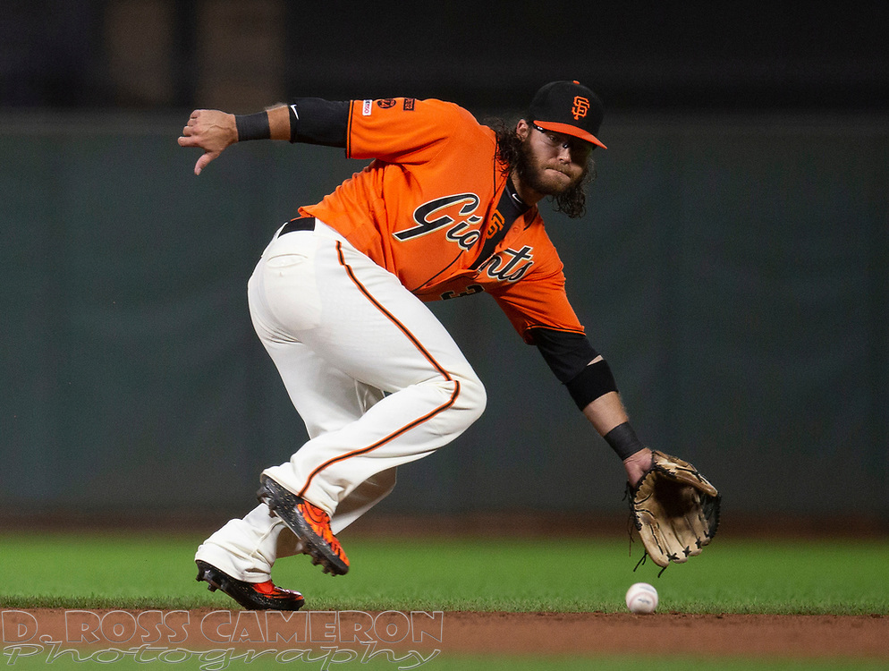 Sep 27, 2019; San Francisco, CA, USA; San Francisco Giants shortstop Brandon Crawford (35) fields a ground ball off the bat of \Los Angeles Dodgers Corey Seager during the eighth inning of a baseball game at Oracle Park. Seager reached on a fielder's choice. Mandatory Credit: D. Ross Cameron-USA TODAY Sports
