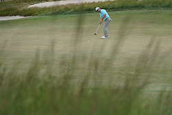 June 16, 2018 - Southampton, NY, USA - Charley Hoffman attempts a birdie putt on the 14th green during the third round of the 2018 U.S. Open at Shinnecock Hills Country Club in Southampton, N.Y., on Saturday, June 16, 2018. (Credit Image: © Brian Ciancio/TNS via ZUMA Wire)