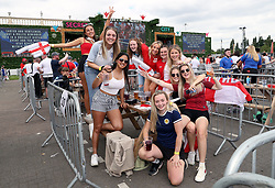 England fans and a Scotland fan at the fan zone in Trafford Park, Manchester as they watch the UEFA Euro 2020 Group D match between England and Croatia held at Wembley Stadium. Picture date: Sunday June 13, 2021.