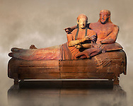 6th century BC Etruscan Sarcophagus known as The Sarcophagus of the Spouses, the in sculpted in clay by the sculptors of Caere, 520-510 BC, Louvre Museum, Paris.  Art Background. To license for non editorial Advertising usage contact The Louvre Paris .<br /> <br /> If you prefer to buy from our ALAMY PHOTO LIBRARY  Collection visit : https://www.alamy.com/portfolio/paul-williams-funkystock/vatican-museums-etruscan.html - Type -       Louvre     - into the LOWER SEARCH WITHIN GALLERY box.<br /> <br /> Visit our ETRUSCAN PHOTO COLLECTIONS for more photos to download or buy as wall art prints https://funkystock.photoshelter.com/gallery-collection/Pictures-Images-of-Etruscan-Historic-Sites-Art-Artefacts-Antiquities/C0000GgxRXWVMLyc
