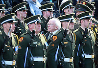 President Michael D Higgins pictured as he inspected the Irish Defence Forces Honour Guard before the  Wreath laying ceremony for the 100th Anniversary of the 1916 Easter Rising at the GPO on Dublin's O Connell St. Picture Credit Frank Mc Grath<br />27/3/16