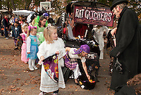 "Holy Trinity School's ""Trunk or Treat"" was certainly a treat for Heather McKenzie as she works her way through the decorated vehicles including ""Ye Old English Rat Catchers"" by Donna Hosmer and Joe Kildune on Monday afternoon.  (Karen Bobotas/for the Laconia Daily Sun)"