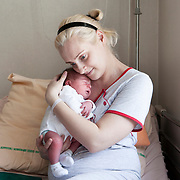 Warsaw, Poland, June 24, 2013. Hospital Anny Mazowieckiej. Natalia, 28 years old, with her son Oliwier, one day old.