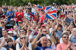 © licensed to London News Pictures. London, UK 07/08/2012. People celebrating Team GB's Triathlon success in the Games as they watching the race's last seconds from a big screen in Hyde Park in London. Photo credit: Tolga Akmen/LNP