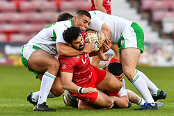 11th November 2018 , Racecourse Ground,  Wrexham, Wales ;  Rugby League World Cup Qualifier,Wales v Ireland ; Rhys Williams of Wales is tackled by Ronan Michael of Ireland <br /> <br /> <br /> Credit:   Craig Thomas/Replay Images