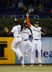 June 13, 2017 - Miami, FL, USA - From left, Miami Marlins players Marcell Ozuna, Christian Yelich and Giancarlo Stanton celebrate after an 8-1 win against the Oakland Athletics at Marlins Park in Miami on Tuesday, June 13, 2017. The Marlins won, 8-1. (Credit Image: © David Santiago/TNS via ZUMA Wire)