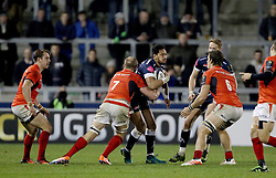 Sale Sharks Denny Solomona is tackled by Saracens Schalk Burger during the European Champions Cup, pool three mach at the AJ Bell Stadium, Salford.