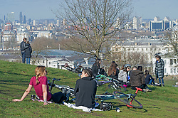 © Licensed to London News Pictures 27/02/2021.        Greenwich, UK. People relaxing in the sunny weather during a third national Coronavirus lockdown in Greenwich Park, London. Photo credit:Grant Falvey/LNP