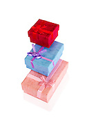 3 gift boxes wrapped in Pink red and blue wrapping paper on white background