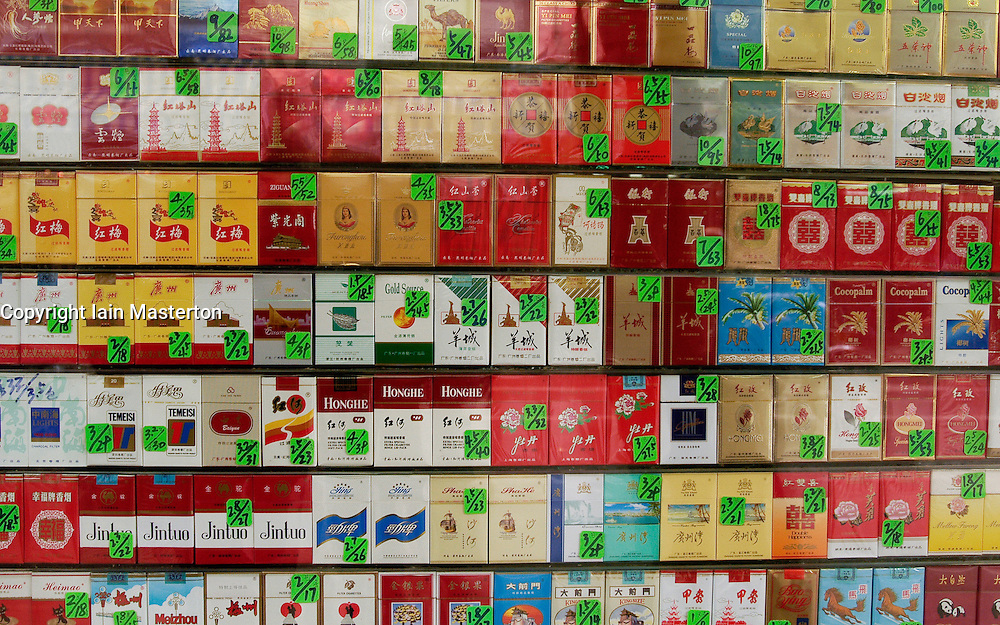 Many brands of cigarettes for sale in a shop in China