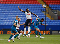 Football - 2020 / 2021 Sky Beat League Two - Bolton Wanderers vs Grimsby Town<br /> <br /> Ricardo Santos of Bolton Wanderers wins a midfield header over Danny Rose of Grimsby Town, at University of Bolton Stadium.<br /> <br /> COLORSPORT/ALAN MARTIN