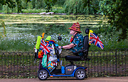 An eccentric on a mobility scooter - Enjoying the sun in St James Park. The 'lockdown' continues for the Coronavirus (Covid 19) outbreak in London.