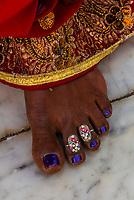 Woman's decorated toes, Prem Mandir Hindu Temple, Vrindavan, India.