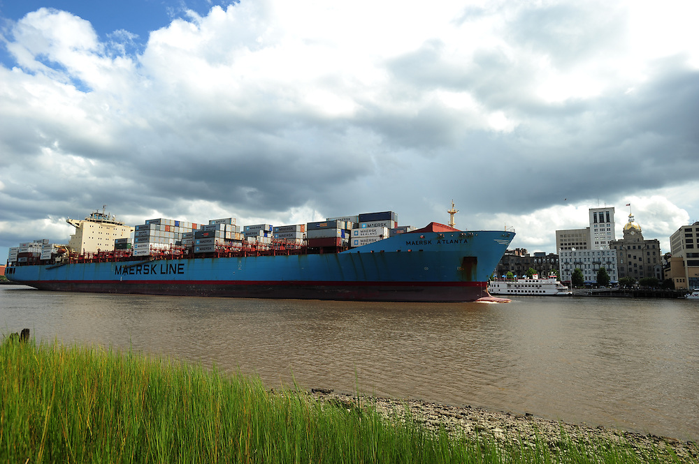 The Maersk Atlanta sails past River Street to the  Georgia Ports Authority , Saturday, July 21, 2013, arriving at the Garden City Terminal in front of Historic River Street in Savannah, Ga.  (GPA Photo/Stephen Morton)