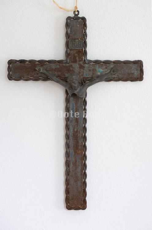 an old broken rusty cross