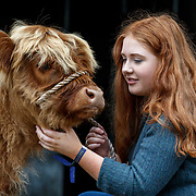 The Royal Highland Show, Scotland's annual farming and countryside showcase, organised by the Royal Highland and Agricultural Society of Scotland.  Laura Hunter (18) from Barnhill Farm, Shotts with a Highland calf.<br /> <br /> Wednesday, June 21, 2017