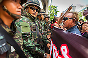 25 MAY 2014 - BANGKOK, THAILAND: Anti-coup protestors and soldiers confront each other in Bangkok. Public opposition to the military coup in Thailand grew Sunday with thousands of protestors gathering at locations throughout Bangkok to call for a return of civilian rule and end to the military junta.     PHOTO BY JACK KURTZ