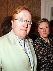 MR & MRS SIMON HEFFER, he is the journalist, at a party in London on 15th July 1999.MUG 46