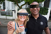 The 49th Notting Hill Carnival in West London. A celebration of West Indian / Caribbean culture and Europe's largest street party, festival and parade. Revellers come in their hundreds of thousands to have fun, dance, drink and let go in the brilliant atmosphere. Stylish sunglasses.
