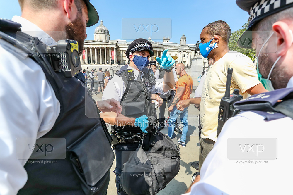 "Police arrest British-African photojournalist Craig Bernard in Trafalgar Square, central London on Sunday, Aug 9, 2020. Bernard was covering a demonstrative action of the environmental activists' group Extinction Rebellion. A Police officer told a member of ""Legal Observers"" in the scene that among the reason why he was arrested for allegedly committing a quote: ""Affray"" and riding an uninsured e-scooter. (VXP Photo/ Vudi Xhymshiti)"