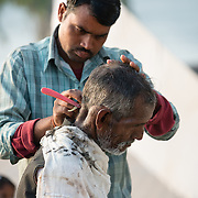 Street barber in village of Orchha, India
