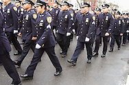Asian police officers in the NYPD march in formation at the funeral for officer Wenjian Liu, a son of Chinese immigrants,  in Dyker Heights, Brooklyn, New York.