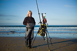 © Licensed to London News Pictures. <br /> 12/10/2014. <br /> <br /> Saltburn, United Kingdom<br /> <br /> Denise Waring from the Redcar Angling Centre poses for a picture during the annual Jim Maidens memorial beach fishing competition in Saltburn by the Sea in Cleveland. <br /> The competition is held each year to mark the death of Saltburn plumber and keen fisherman Jim Maidens who died in 1998 when he was killed after being swept overboard from his boat 'Corina' close to the beach at Saltburn.<br /> <br /> Photo credit : Ian Forsyth/LNP