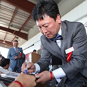 Boxer Myung-Woo Yuh signs autographs just after being inducted into the Hall of Fame during the 2013 International Boxing Hall of Fame induction ceremony on Sunday, June 9, 2013 in Canastota, New York.  (AP Photo/Alex Menendez)