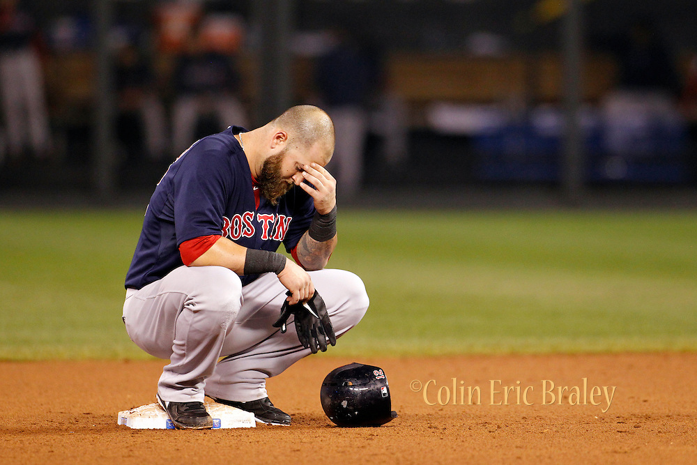 Boston Red Sox' Mike Napoli rests on second base during a pitching change after scoring 3 RBI's in the fourth inning of a baseball game against the Kansas City Royals at Kauffman Stadium in Kansas City, Mo., Friday, Aug. 9, 2013. (AP Photo/Colin E. Braley)