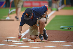 March 26, 2018 - Houston, TX, U.S. - HOUSTON, TX - MARCH 26: Grounds crew clean home plate before the game between the Milwaukee Brewers and Houston Astros at Minute Maid Park on March 26, 2018 in Houston, Texas. (Photo by Ken Murray/Icon Sportswire) (Credit Image: © Ken Murray/Icon SMI via ZUMA Press)