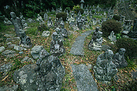 """Rakan Disciples at Seikenji  - Seikenji is a Buddhist temple of Rinzai sect in Okitsu Shizuoka. Seikenji''s origins began as a result of its location along the ancient Tokaiko Road, leading from Kyoto to Edo Tokyo, as this point was a """"sekiisho"""" or checkpoint along the way. It is considered to be a good place to view the moon especially in the past when it had an unobstructed view of overlooking Suruga Bay. There are statues of 500 disciples, worn and weathered with age, leading up the hill as well as a plum tree planted by Tokugawa-Ieyasu. Seikenji garden was built in the 18th Century, and has been designated as a scenic spot of Japan.  Seikenji is believed to have been founded in the 7th century during the Kamakura Period along the historic Tokaido Road. From a passage at the rear of the  temple's interior, and inner tatami rooms overlooking the garden, which are the best vantage points to view the exquisitely landscaped Zen garden.  When Tokugawa-Ieyasu was a child, he was sent Seikenji as a refuge of the Imagawa Family."""